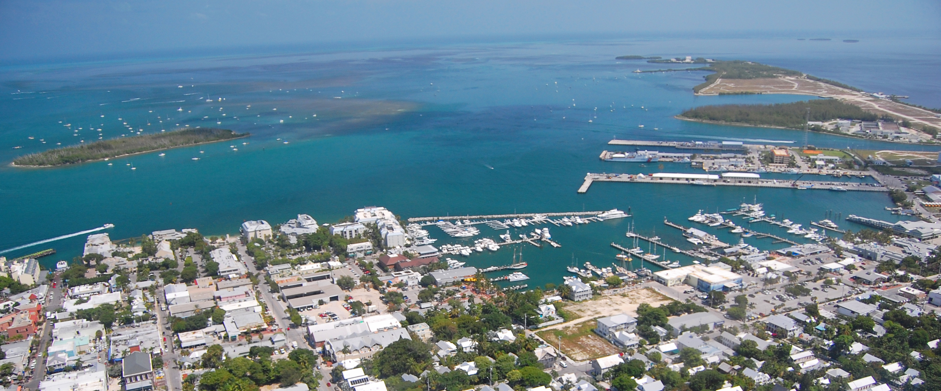 Aerial view over Key West looking north with Duval Street and the Key West Bight Marina.