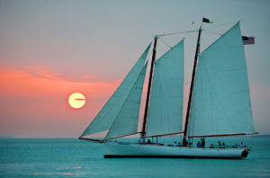 Sailboat on the water as the sunsets at the Key West Historic Seaport in Key West.