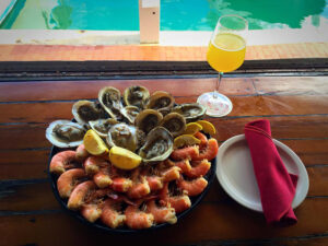 oyster and seafood on plate with drink and napkin